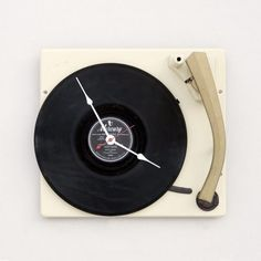 Clock made from an old record turntable! Would be a great way to showcase an awesome vinyl record label, even without the turntable.