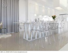Low angle modern dining table with clear plastic chairs - love this in a room with lots of windows and a view to die for