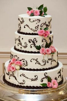 Order a plain white cake for way cheaper then one decorated... for a fraction of the cost we can add flowers, fabrics, jewels, etc.   Get a cake that WOWS for a fraction of the cost...  Money saving tips, DIY Wedding Cake, Amazing wedding cakes. jeweled wedding cakes, pink white and black wedding cake