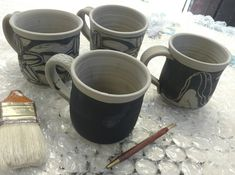 Beginning sgraffito mugs. Sgraffito, Bass, Coffee Maker, Kitchen Appliances, Pottery, River, Tableware, Coffee Maker Machine, Diy Kitchen Appliances