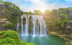 Download wallpapers beautiful waterfall, China, forest, trees, lake, sunrise