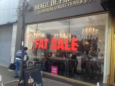 Sale sticker applied to large window for image de force. Printed and installed by sign A Rama Box Hill.