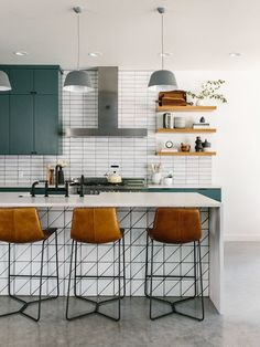 Our Austin Casa || The Full House Tour - MidCentury Modern Kitchen and Bar with leather Barstools and Fireclay 2x8 Stacked White Glazed Brick Tile -  Floating Shelves - The Effortless Chic