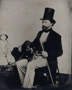 c. 1860s [tintype portrait of a gentleman and his dog and a small child, barely visible to the far left of the image] via I Photo Central