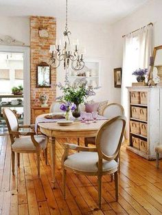 Love the farmhouse feel of this dining area, especially the exposed brick.