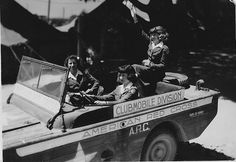 """Clubmobile Division: American Red Cross - in a """"swimmable Jeep"""", a Ford GPA amphibious Jeep - to cross rivers and lakes."""