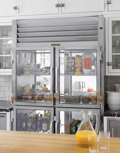 glass front industrial style fridge
