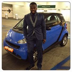 New ride: 50 Cent poked fun of his own bankruptcy crisis by posing next to a compact Smart Car on Tuesday, joking, 'Times are hard' Celebrity Gist, Celebrity Gossip, Celebrity News, Peugeot, Rapper 50 Cent, Rick Ross, Smart Car, Hip Hop Artists, The Hollywood Reporter
