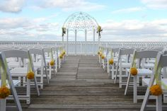 Outdoor wedding ceremony with yellow pomander aisle markers by My Flower Box/The Happy Couple Photography