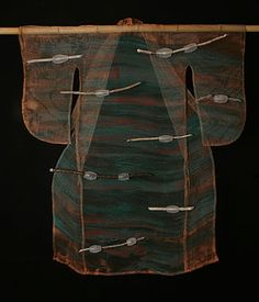 """""""Kangae"""" (carried by currents)  43""""h x 37""""w x 2.5""""d  Blown glass, copper mesh, stick"""