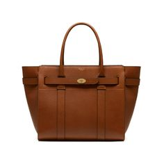 Shop the Zipped Bayswater in Oak Natural Grain Leather at Mulberry.com. The Bayswater is our most iconic bag, and its eponymous collection includes new styles inspired by the original. The Zipped Bayswater is the perfect option for those who like a zipped closure. Using the same construction as a Bayswater, this new style plays with the detail – deconstructing the front by removing the flap and using the iconic postman's lock to secure two belted straps.