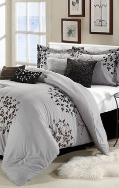 Silver Chiela Comforter Set ~ our new comforter, I like the brown picture frame accent.