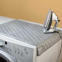 Padded Magnetic Ironing Blanket converts the top of your dryer or washer into an ironing board. $14.99
