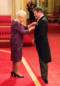 telegraph:  Queen Elizabeth held an investiture at Buckingham Palace, and awarded designer Stewart Parvin a Royal Victorian Order, and paid him the compliment of wearing a purple day dress that he designed, March 1, 2016