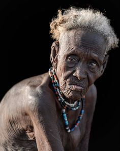 """Trevor Cole on Instagram: """"An old lady from the Dassenech tribe who live in the delta region of the Omo river. The Dassenech are pastoralists but also hunt for…"""" Crocodiles, African Art, Old Women, Tourism, River, Ageing, Lady, Photography, Traditional"""