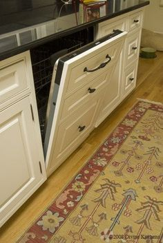 cover the dish washer so it blends in with the cabinets- super cute idea
