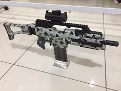 This week blaster, Tri-Camo G36C Stryfe! It will be up in store in another 8 hours so stay tuned! Paint job is done by our local nerfer, Billy. Huge shoutout to his awesome paintjob :D Sneaked in some honeybadger retaliator while we finishing up the G36C