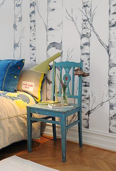 tree wallpaper bedroom Love the color of the blue chair too!