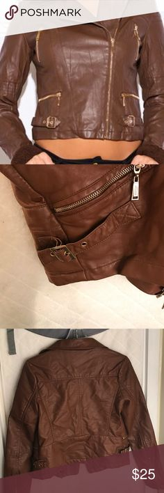 JouJou Faux leather Moto jacket Cute moto jacket bought for my daughter I don't think she ever really wore it cognac brown color. Zippered sleeve, buckles for cinching at waist vertically drawing eye in zippered pocket. Please ask questions Jou Jou Jackets & Coats