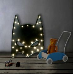 BATMAN MARQUEE LIGHT BLACK:  This cool Marquee Night Light will have your kids jumping into bed in no time and will add lots of fan to their room.