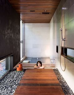 Lovely luxurious bathroom with a recessed soaking tub in a tranquil and minimalistic environment with lots of natural materials.