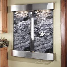 This mountable water feature fountain is one of my favorite interior design pieces.  Check us out at http:///www.waterfeaturesupply.com/waterwalls/indoor-wall-water-fountains.html to learn more about regarding this wall mounted water wall.