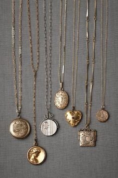 i got a vintage locket from my husband for my wedding gift.  i am so attracted to old lockets, how beautiful are these?!!