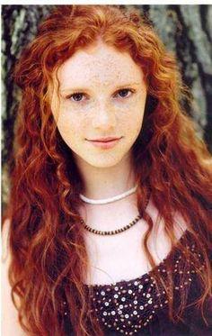 Kiana - redorange, lots of freckles, super curly