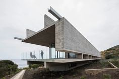 #Architecture: Huge concrete beams frame ocean views from a 'levitating' coastal home in Chile.