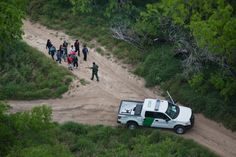 A Border Patrol officer approached Hondurans and Guatemalans who had just crossed the Rio Grande in a year when border crossings surged. (Photo: Todd Heisler/The New York Times)