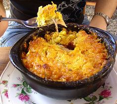 Pastel de Choclo -Chilean ground beef casserole with corn batter topping - The meat filling for this recipe is called pino and is also used to fill the famous Chilean empanadas. (This picture looks 'artery-cloggingly' delicious, but I think the recipe culd be lightened up without hurting the flavor.)