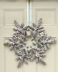 Long, slender pinecones, such as those of a white pine, work best for this new take on a Southern holiday classic—the pinecone wreath. Finish with a narrow ribbon layered on top of a wider ribbon. Learn how to make this snowy pinecone wreath Pine Cone Art, Pine Cone Crafts, Christmas Projects, Pine Cones, Holiday Crafts, Holiday Decor, Pinecone Christmas Crafts, Pinecone Decor, Thanksgiving Holiday