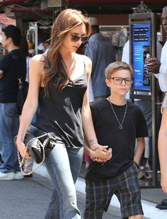 Victoria Beckham and Romeo go shopping in LA for Memorial Day | See the pics