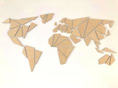 A beautiful and original Wooden World Map Wall Art Unique large geometric wood world map wall art, crafted out of self-adhesive wood panels. ✓ Adds a stylish, modern touch to any room or office ✓ 100% original and 100% made out of quality wood materials ✓ Self-adhesive backside,