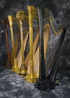 An array of harps in the H. Bryan & Co. shop today: 1782 béquille action by Simonin, Erard Grecian, Erard scroll top, Lyon & Healy Style 23, and carbon fiber pedal harp by Dave Woodworth.