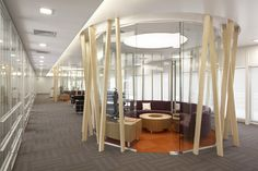 Nextel Argentina Head Office. The informal meetings and video conferences rooms were designed inside large glass cylinders, surrounded by a series of maple-wood rods. Inside, curved sofa velvet grape and a tangerine tone rug exalt the climate for creativity