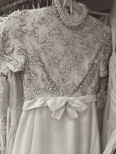 How stunning is this dress? The beading is something you won't find anywhere else.  Shop the look at http://www.millcrestvintage.com/.  #Beading #WeddingDress #MillCrestVintage