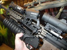 Aimpoint for your M203 Grenade Launcher? Yes.
