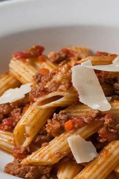 Grace Parisi's pasta Bolognese features a traditional combination of ground beef, pork, veal and tomato enriched by smoky pancetta. #pasta #pastarecipes #pastainspiration #pastadinner #pastaideas #pastadinner #pastaideas Noodle Recipes, Pasta Recipes, Beef Recipes, Dinner Recipes, Cooking Recipes, Pasta Meals, Dinner Ideas, Pancetta Pasta, Lotsa Pasta