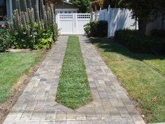pavers with grass ribbon driveway