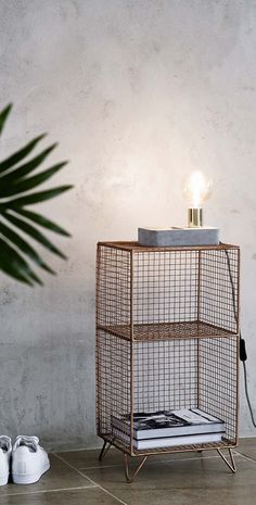 Designed to sit on your bedside table, a luxe gold stem captures a naked LED bulb while a smooth concrete base showcasing natural blemishes, features a tray to hold your trinkets at night time. Bulb not included.