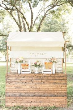 Reception Sangria bar? Si, por favor!!   This light and airy white wine Sangria bar is the perfect addition to a Spring or Summer garden wedding. The fresh strawberries, oranges and peaches in the sangria add pretty pops of color and brightness to a natural & neutral color palatte.   Event Design: @RWEvents Photography: @amalieorrangephotography
