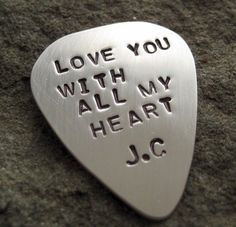 Sterling silver personalized guitar pick  http://delaneygates.typepad.com/my_weblog/2009/02/valentines-day-gift-ideas-for-men-2009.html