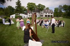 sylvia norris playing harp at mackinac island wedding at the inn at stonecliffe by paul retherford wedding photography