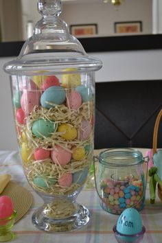 Kim...for your wall.    Fill a hurricane with Easter grass and decorative eggs for a great centerpiece.  Easy and Cheap! Also, fill small hurricanes with jelly beans and put candles in the center.  Plastic eggs with names as place cards.