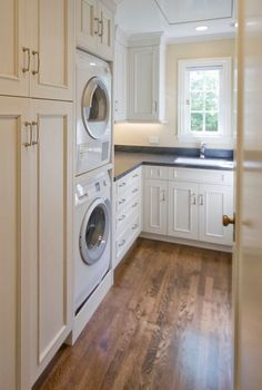 stacked washer and dryer and laundry baskets stacked in cabinet beside....detergents above