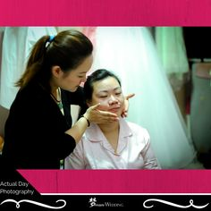 Our actual day wedding photography of our couple for their actual day wedding. Our beautiful bride, lily, doing makeup done by our makeup artist in the morning. Getting prepared for her big day! Dream wedding boutique singapore top bridal wedding planner. For more info, visit www.dreamwedding.com.sg
