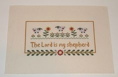 """This hand stitched cross stitch piece measures 11 1/2""""x8 1/4"""". The stitched area is 7 3/4""""x4 1/4"""". The design reads """"The Lord is my Shepherd"""" with 3 sheep and a row of flowers above. The piece is stitched on 14 count ecru Aida cloth and can easily be trimmed to the needed size. Perfect to frame, make a pillow or finish any way you choose. New, made for sale.  $7.00"""