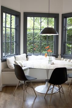 modern kitchen eating nook with banquette seating
