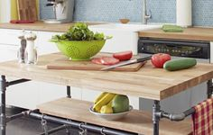 Combine iron threaded pipe and butcher block to create a kitchen centerpiece